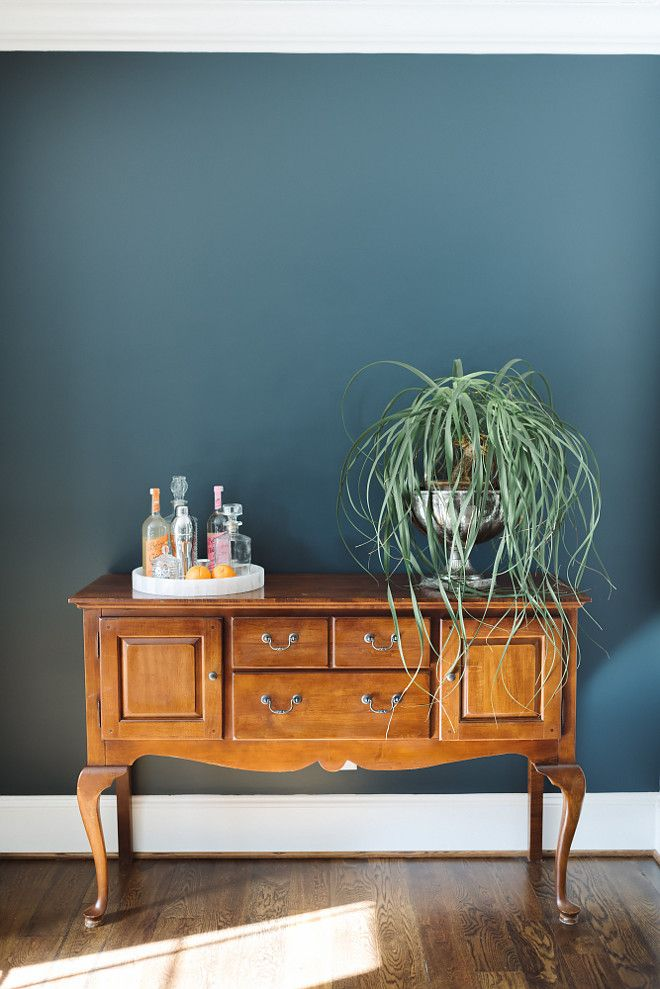 Wall paint color is Mount Etna by Sherwin Williams.  Bar tray is Home Goods with vintage decanters.