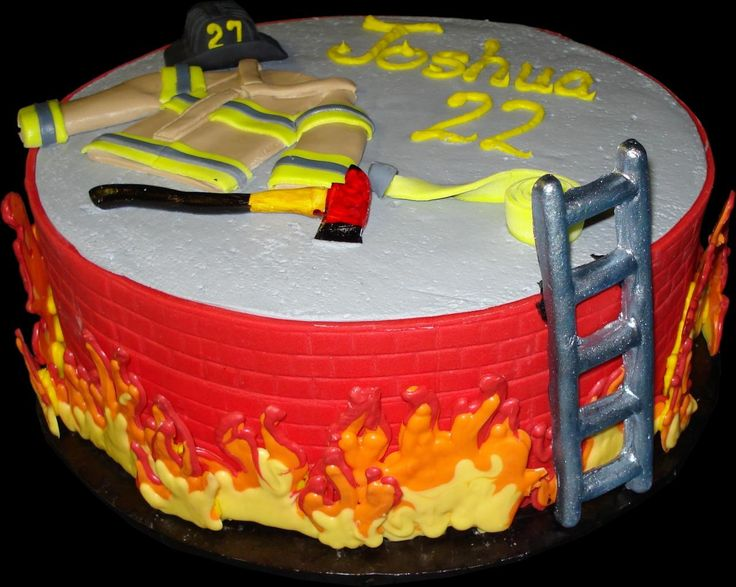 Fire Fighter Birthday Cake. White buttercream iced, round decorate with an edible brick wall, fireman's jacket, axe, helmet, hose, ladder and flames. Everything on this cake is edible. (Serves 8-80 party slices.)