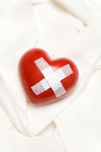 Heart glued with band aid