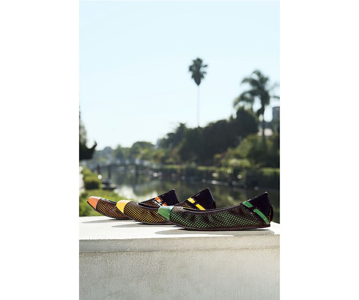 The #HOGANREBEL R233 ballerina  in black mesh with a touch of orange, green or yellow.