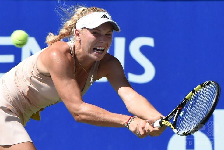 女子テニス、東レ・パンパシフィック・オープン(Toray Pan Pacific Open 2014)シングルス決勝。リターンを打つカロリーネ・ボズニアツキ(Caroline Wozniacki、2014年9月21日撮影)。(c)AFP/Toru YAMANAKA ▼21Sep2014AFP|イワノビッチがボズニアツキ下し優勝、パンパシフィック・オープン http://www.afpbb.com/articles/-/3026577