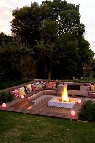 Sunken fire pit with seating. While this is a neat idea, I would be hesitant about how rain would affect this area. Definitely would need to put in a drain somewhere or have it open up to the rest of the yard.