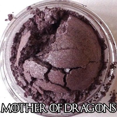 Mother of Dragons Eyeshadow - Indie Makeup. Daenerys Stormborn of House Targaryen, Queen of the Andals and the First Men, Khaleesi of the Great Grass Sea, Breaker of Chains, and Mother of Dragons. Not lip-safe. Silvered royal purple over a blood-red base. Full size (pictured) weighs 2.0 grams. Ingredients: mica, carnauba wax, titanium dioxide, iron oxide, tin oxide, aluminum powder, silica.