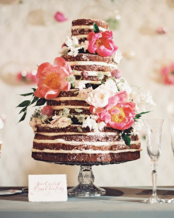 The bridehad her heart set on a naked caked topped with fresh flowers, and we can see why!She and her groom cut into this towering spiced-carrot confection, which was flanked by mini cakes in other flavors, all created by Cakewalk Bake Shop.