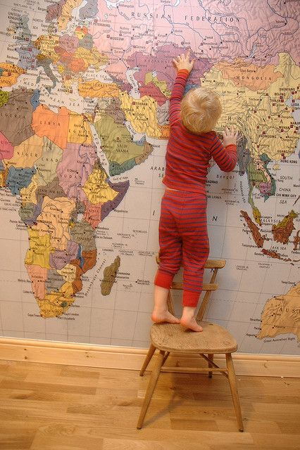 world map mural on one playroom wall (blue oceans!)