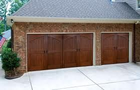 38 best my garage carriage house images on pinterest for Wood composite garage doors
