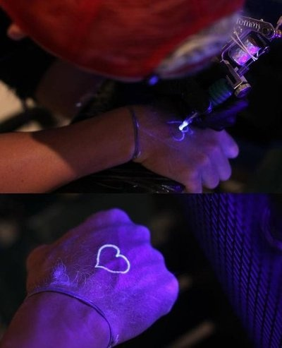 UV ink tattoo - most awesome thing in the world.  It only shows up under a black light.