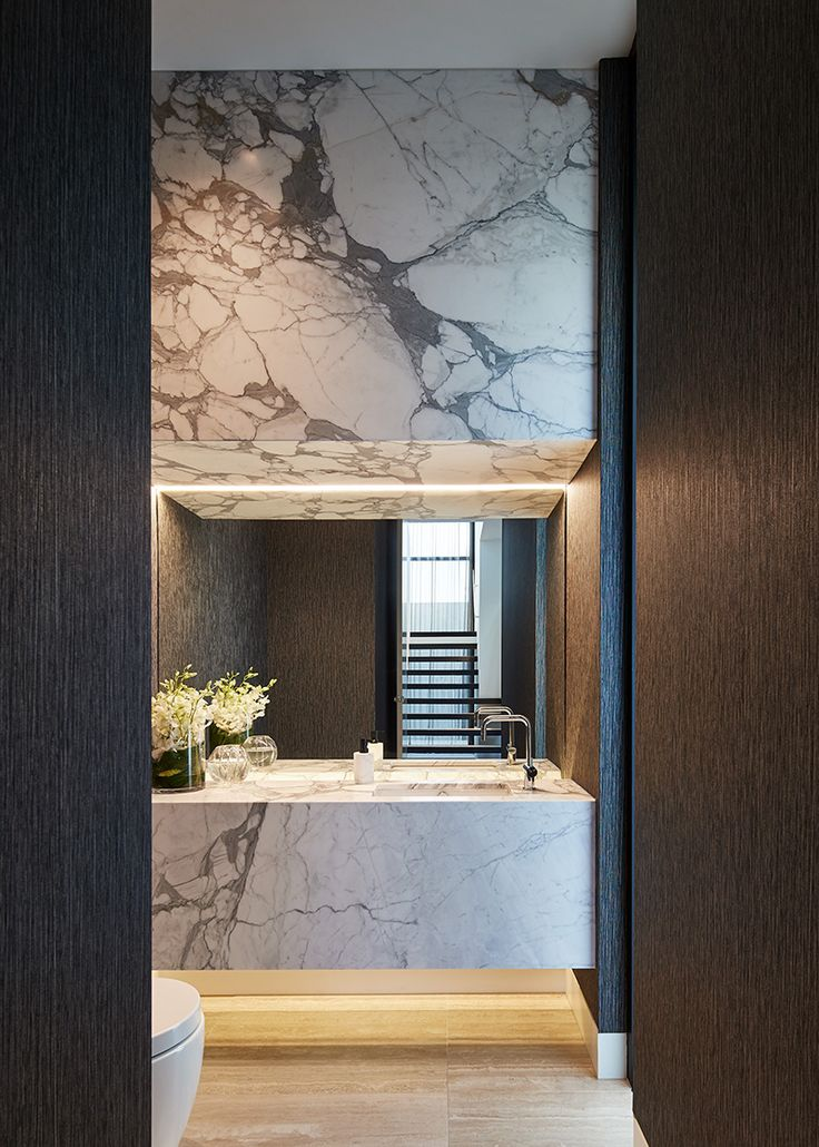 The clever use of smoked mirrors/metalwork and cabinetry help create an illusionary delight in this Toorak Home by Aristacon.  Italian stone floors, imported wallpapers and fine fixtures and fittings compliment this stunning home.  Builder: Aristacon | Architect: David Watson Architects | Interiors: Travis Walton Architects | Photography: Peter Bennetts  Product Selected: Scala Collection in Chrome available from Reece Bathrooms.