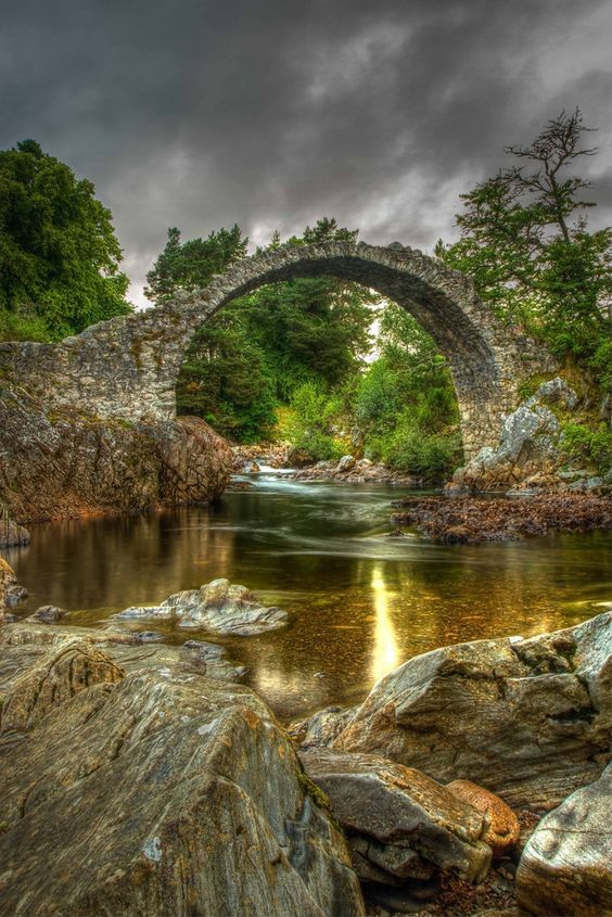 The dreamy Packhorse Bridge in Carrbridge, Badenoch and Strathspey, the Scottish Highlands.