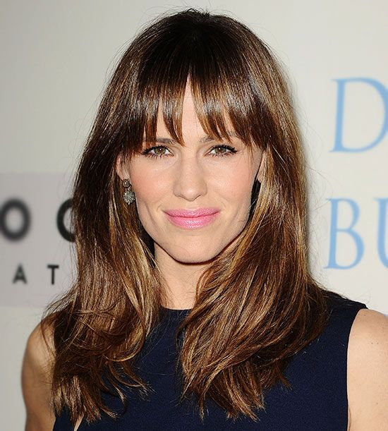 Jennifer Garner - bangs, not too blunt & slightly bendy blowout can make you look younger.  Blunt bangs with super-straight hair can emphasize crow''s feet.