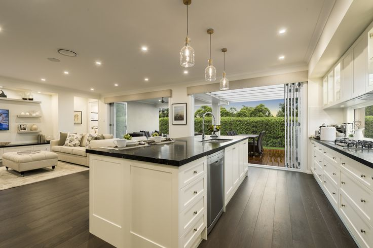 A hint of Hamptons brought into the kitchen and living space of our Miami Executive on display at Sapphire Beach. For details see http://mcdonaldjoneshomes.com.au/display-home-locations/sapphire-beach #hamptons #style #interiordesign #styling #home #coast #cabinetry #benchtop #stonebenchtop #stonebench #floorboards #floors #flooring #timber #newhome #pendantlights #pendant #lights #livingroom #living #kitchen #outdoors #appliances