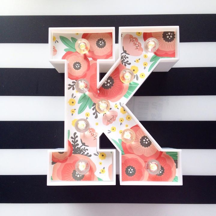 Get Heidi Swapp marquee letters at Target and add your favorite paper. Add lights and voila! Super, duper cute!!!