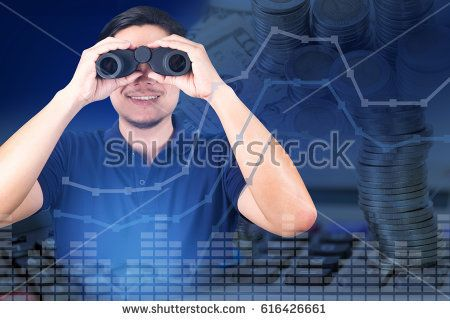 Double exposure of Asian investor with binoculars with growth graph chart and blurred stacks of coins with calculator background, business vision concept.