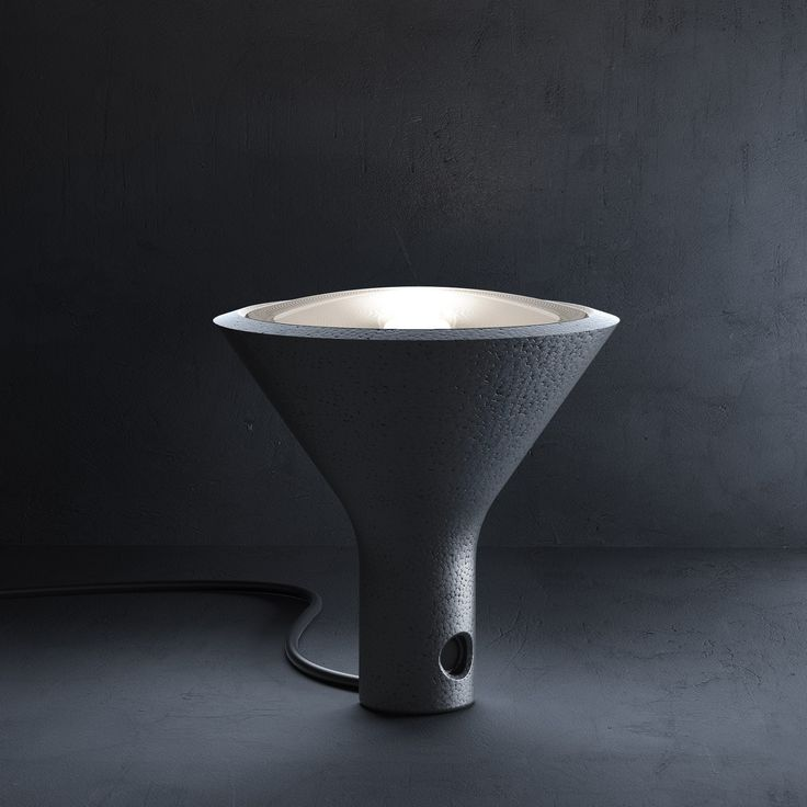 Yupik (lighting): Portable lamp. Body in polypropylene foam, available in pale grey and black. Diffuser in clear polycarbonate. Fitted with 5-metre black power cable, allowing the lamp to be moved and placed on a surface with the light source directed upwards, laid on one side or even hung up, thanks to a hook that can be used for holding the cable. (designer: Form us with love   2013) - More @ www.fontanaarte.com #fontanaarte #light #lamp