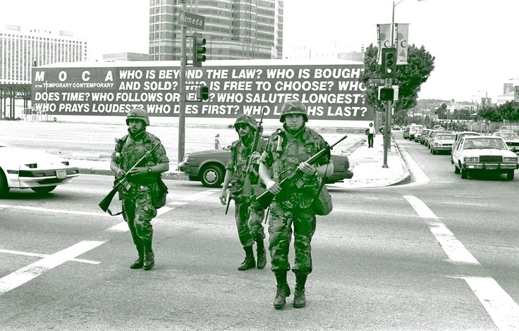 It has been 20 years since the L.A. riots. Here's a photo taken on May 1, 1992, by Gary Leonard of national guards on patrol at 1st St. and Alameda St. after the verdicts of the Rodney King trial were announced. Behind them is Barbara Kruger's mural on the wall of what was then The Temporary Contemporary (now The Geffen Contemporary at MOCA).