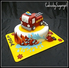 gorgeous tired fire truck cake. love the fire truck design and the fireman putting out the flames :) these people are too talented!