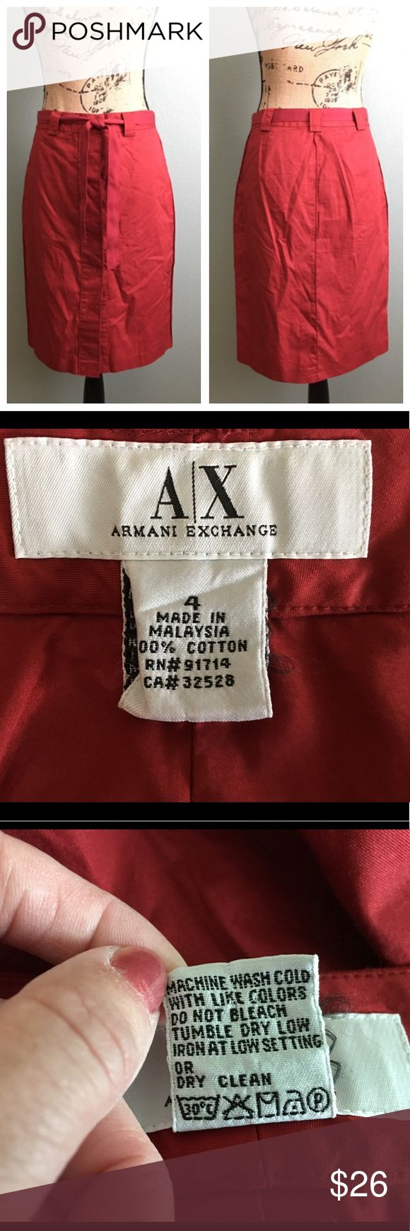 "A/X Armani Exchange size 4 red buttoned skirt! A/X Armani Exchange size 4 red buttoned skirt! Great condition. Matching tie belt is included. Buttons up the front. Fabric is lightweight. Skirt is unlined. Hens have a raised rough look/texture. Approximate flat measurements: waist 15"", hips 18.5"", length23"". I don't trade. Reasonable offers welcome. Thanks! 😊 A/X Armani Exchange Skirts"