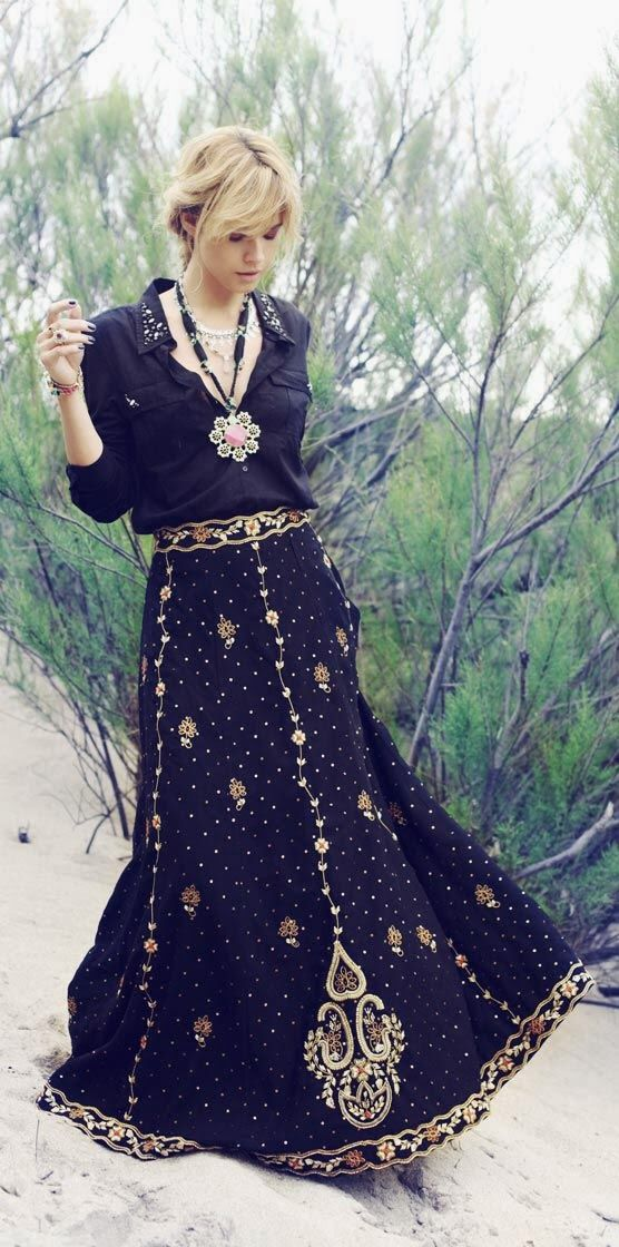 Bohemian fall fashion. . Black Blouse With Neckless And Black Floral Embroided Maxi Skirt