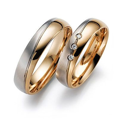 Lovely pair of yellow and white gold rings.