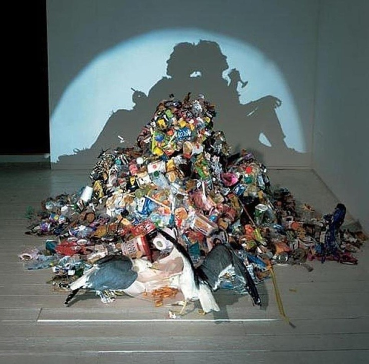 Silhouette of two people smoking and drinking made completely of trash and rubbish!