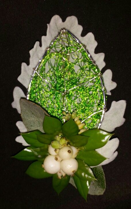 Today's boutonierre, dusty miller snowberries, buford holly and iliagnus on a custom wire leaf base