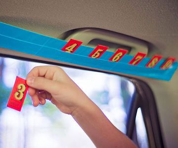 """Before starting out on their first major expedition (an 18-hour drive to Florida from their home in Springfield, Ohio) with their 2-year-old and 4-year old, the Larsons hung little numbered tickets above each boy's car seat, one for every hour of the trip. """"They were redeemed for wrapped treats they could play with or eat along the journey,"""" says mom Therese. """"They loved pulling down the ticket when I asked in my conductor voice: 'Tickets, please!'""""                 Jennifer Guckiean of…"""