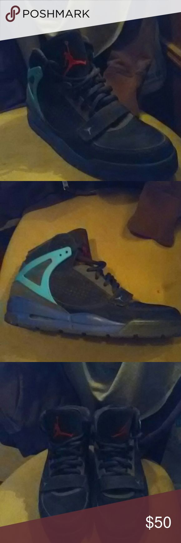 Jordans size 13 Black, turquoise, and purple Jordan's. In good condition no wear on bottom of sole, no stain or rips. They are used but still in good condition. Plz look at pic before you purchace Jordan Shoes Sneakers