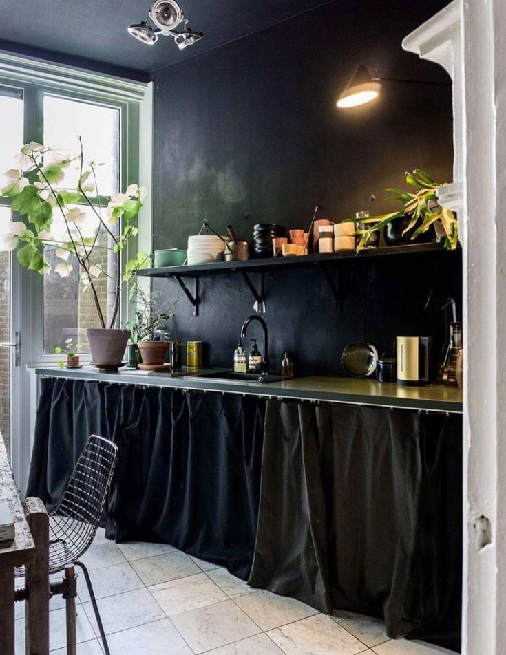 kitchen with black walls and textiles. / sgirlbybay