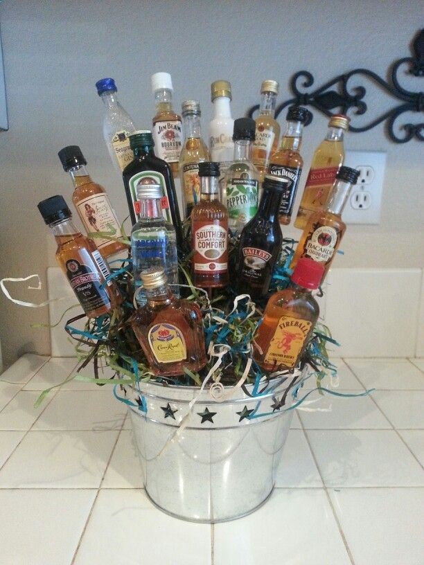 Bouquet of booze!! Super easy!!! Supplies needed.... bucket, skewers(wood), floral green foam, mini bottles of liquor, glue gun gift filler/stuffing. Other things Ive added are Cigars, lottery tickets eyc.. I Made this for my husband for a gift.
