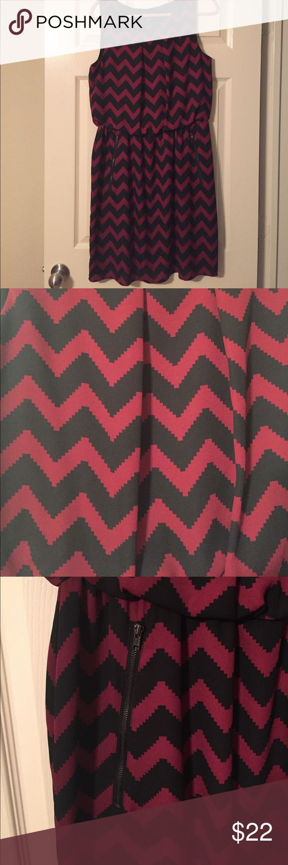 Red and Black Chevron Print Dress with Pockets LAST CHANCE, going to Goodwill on Friday, July 14! All reasonable offers will be accepted. New without tags's red, almost maroon, and black chevron print dress with cinched waist and zipper front pocket. Size 16! Extremely cute on but unfortunately was too big and I had already removed the tags. Great for work or date night. The skirt is lined. Non-smoking home. Dresses Midi