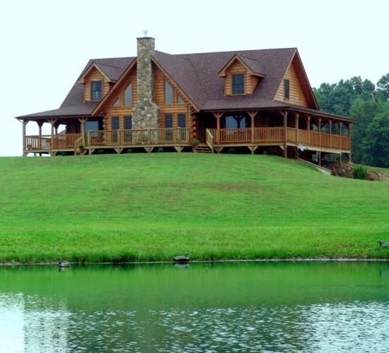 """Peaceful Beauty ~ This is another one of Log Homes that make me wish I could say: """"Honey, I'm HOME!"""" Look at that Wrap-Around Porch ~ and this one is on the Water!"""