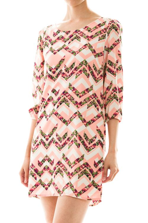 Amazing pink chevron dress with fun contrasting floral print, 3/4 sleeve and exposed zipper at the back. What more could you need to make a Spring statement?