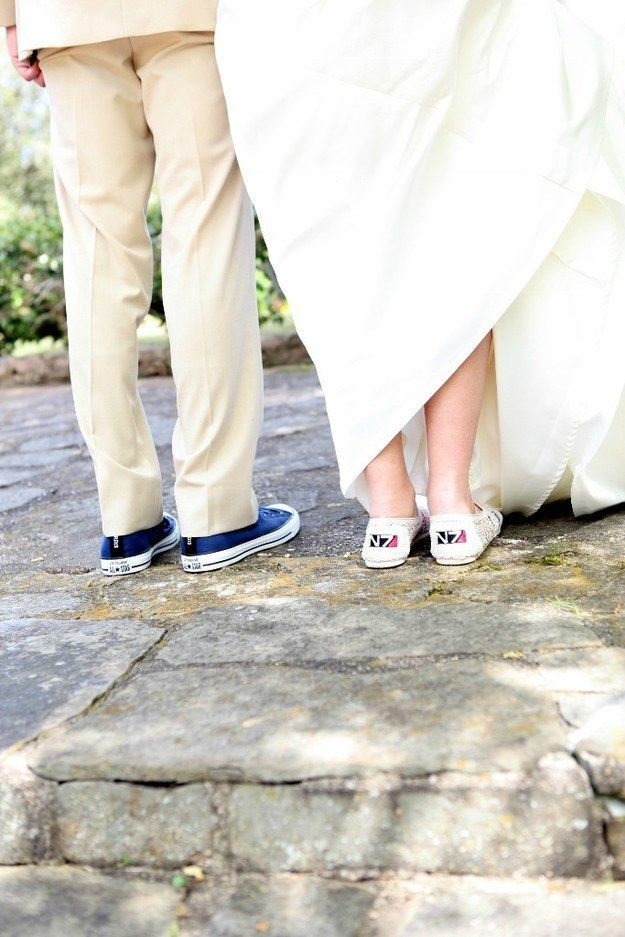 The bride's shoes were Mass Effect-themed and the groom's were Doctor Who.