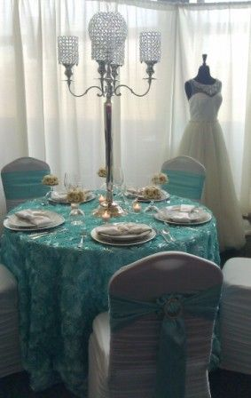 {Wedding Design} Wedding at Tiffany's | Tiffany Blue Wedding. Not into the Breakfast at Tiffany's theme but love how the wedding dress is on display at the shower
