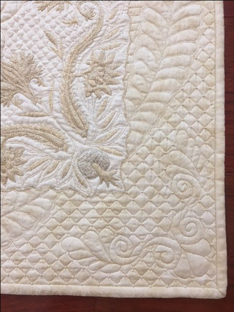Close up of linen wholecloth quilt done by Kathy Heystee.