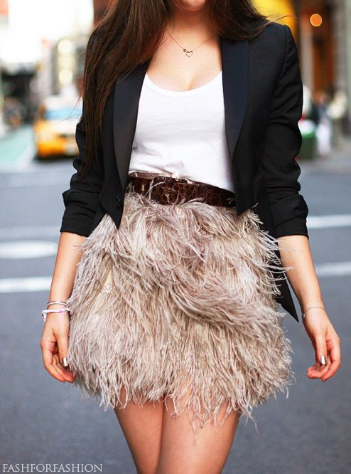 I like how this feather skirt is dressed down with a basic tee and blazer... nice... it's like eccentric prep