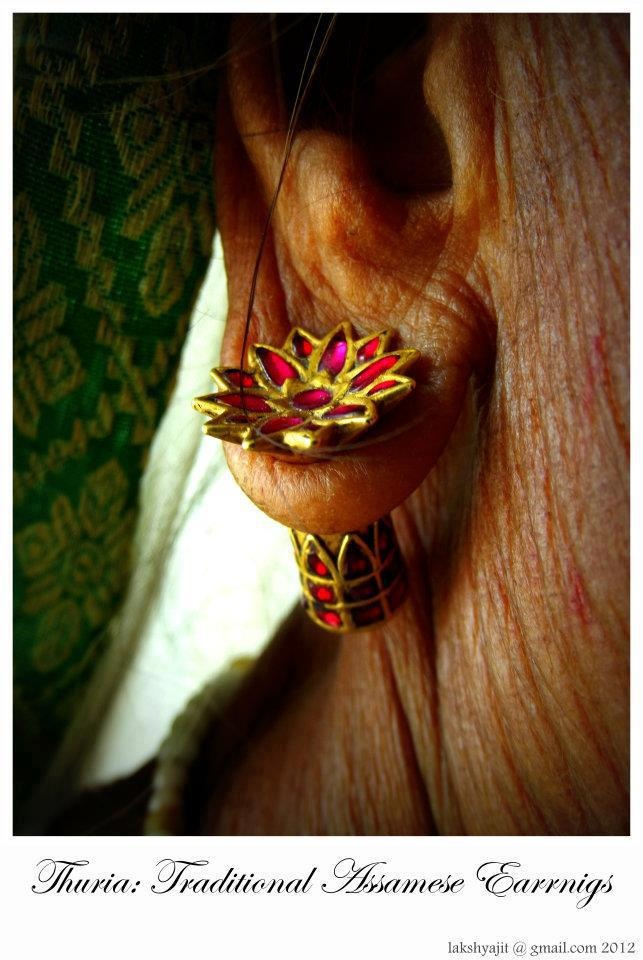 """Thuria : traditional Assamese earrings. Photographer:Lakshyajit Gogoi About:Ear Ornaments called """"thuria"""" from Assam. Worn in the lobe by women . The form symbolizes a lotus with a heavy stem —"""