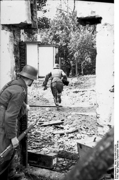 """gruene-teufel: """"German soldiers cautiously move between houses as they search for and engage British paratroops in the village of Osterbeek, 5 km west of Arnhem, September 1944. """""""