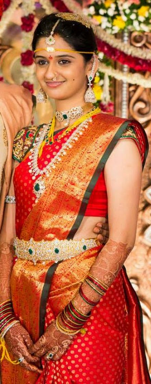 South Indian bride. Temple jewelry. Jhumkis.Red silk kanchipuram sari.Braid with fresh jasmine flowers. Tamil bride. Telugu bride. Kannada bride. Hindu bride. Malayalee bride.Kerala bride.South Indian wedding