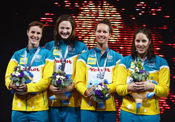 (L-R) Silver Medal winners Bronte Campbell, Cate Campbell, Emma McKeon and Alicia Coutts of Australia celebrate on the podium after the Swimming Women's4x100mFreestyle on day nine of the 15th FINA World Championships at Palau Sant Jordi on July 28, 2013 in Barcelona, Spain.
