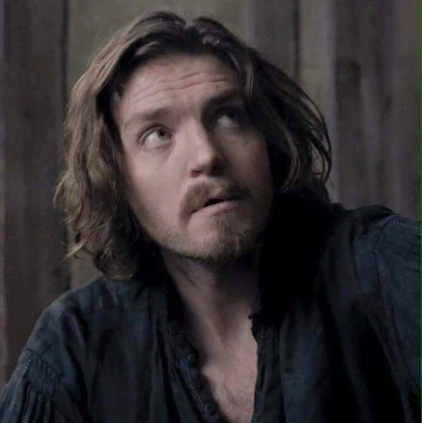 Tom Burke as Athos on The Musketeers