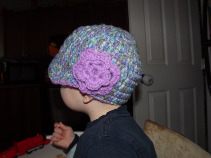 my 2 yr old modeling one of my hats!  He's a good sport!!