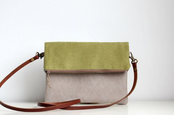 Lovely fashionable fold over crossbody handbag made with quality upholstery fabric for the outside cotton fabric for the lining.  ||| Love, but flat with no interior pockets/ organization