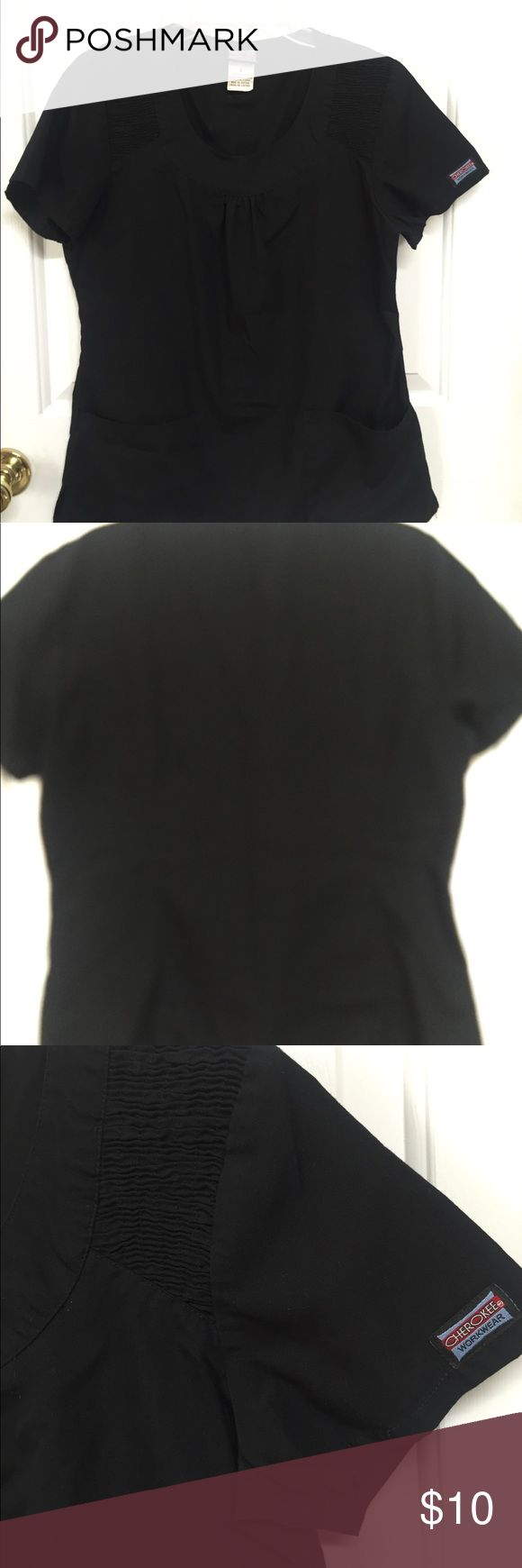 "Cherokee Workwear Scrub Top #4761 Round neck BLACK PRODUCT DESCRIPTION  Cherokee #4761 Size Small  Bust 35-36""  Waist 27-28""  Hip 37-38""  Female Round Neck Top is a stylized round neckline scrub top featuring elasticized smocking at the shoulder seams, patch pockets, slight shirring at the centre front, and back princess seams. Fabric is made from 65% Poly/35% Cotton Poplin with Soil Release Cherokee Tops"