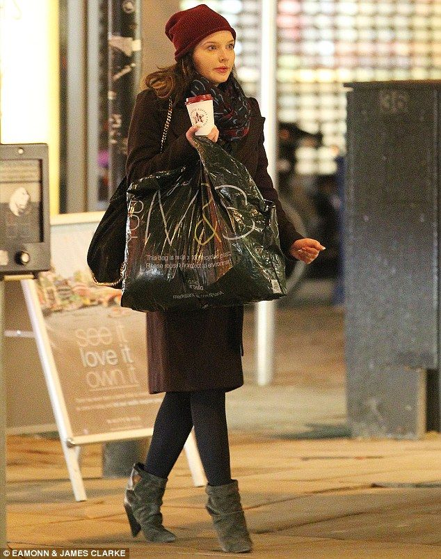 Taking advantage of the January sales: Pregnant Helen Flanagan covered up her baby bump as...