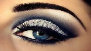 1.take a silver eye shadow and apply to lid   2.put a navy blue eye shadow in your crease  3.put white eye shadow  on your brow bone  4. make a cat eye