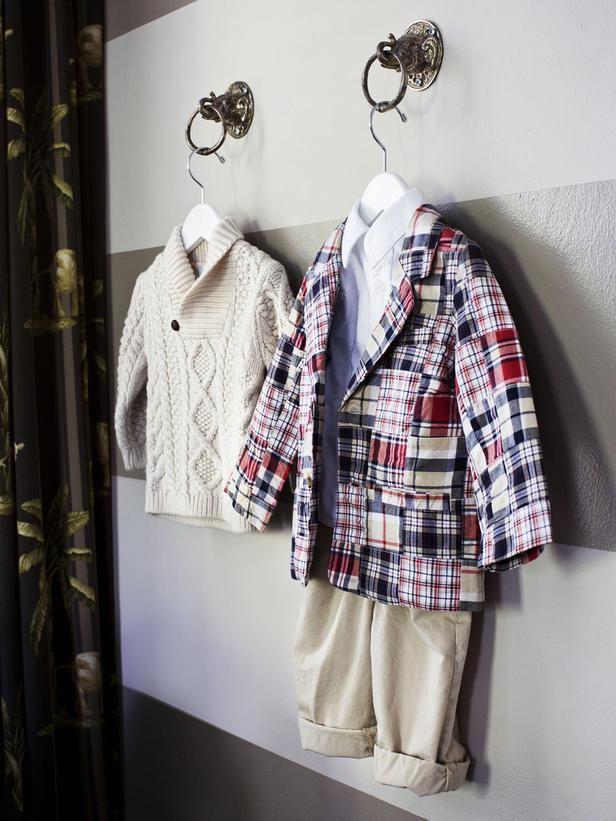 Drawer pulls repurposed as clothing hooks. Genius! {Vern Yip, via HGTV magazine}