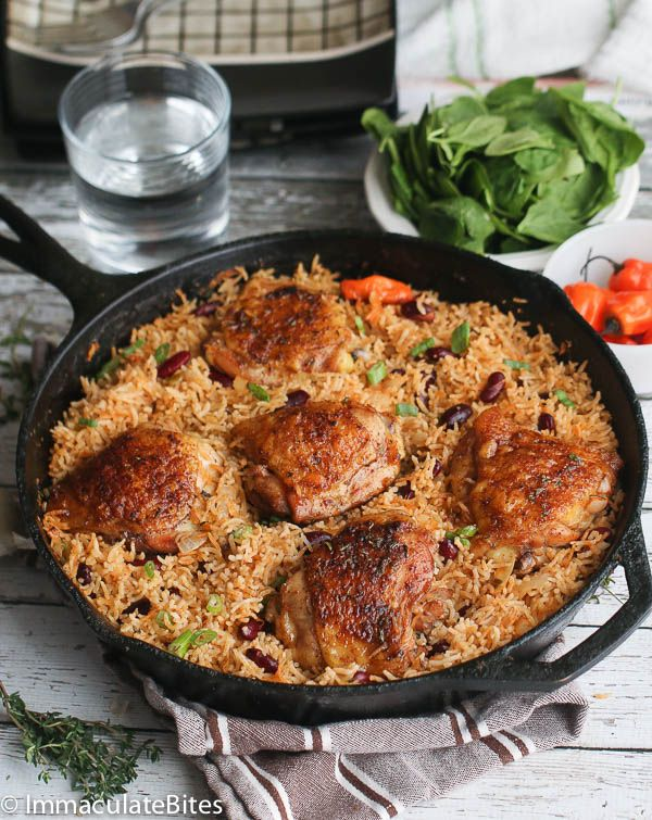 One Pot Jerk Chicken & Rice- Thighs baked to Crispy perfection on a bed of fragrant rice and beans. A flavor explosion in a pot!