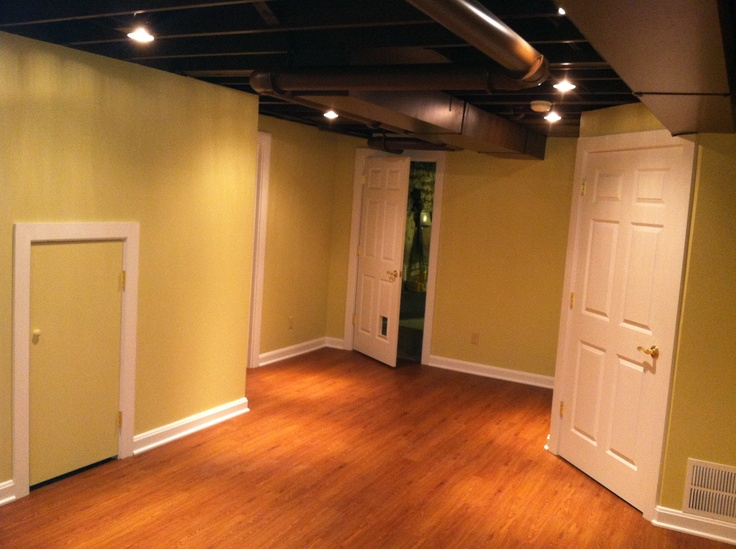 Exposed floor joists in finished lower level cool basement ideas pinterest basements - Low ceiling basement ideas ...