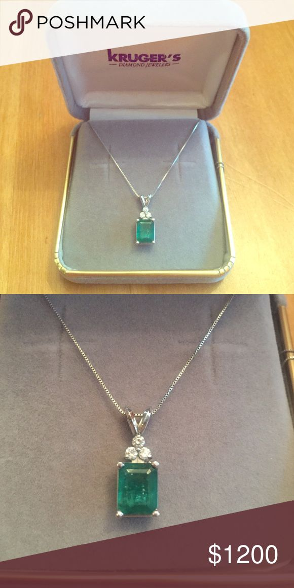 "Emerald & diamond pendant with 14k white gold ch. Kruger's Jewelers Emerald and 3-Diamond (1.1 ct) drop pendant with 14k white gold chain (18""). Emerald is rough cut but can be refined at a jeweler's shop. Diamonds are high quality. Kruger's Jewelry Necklaces"